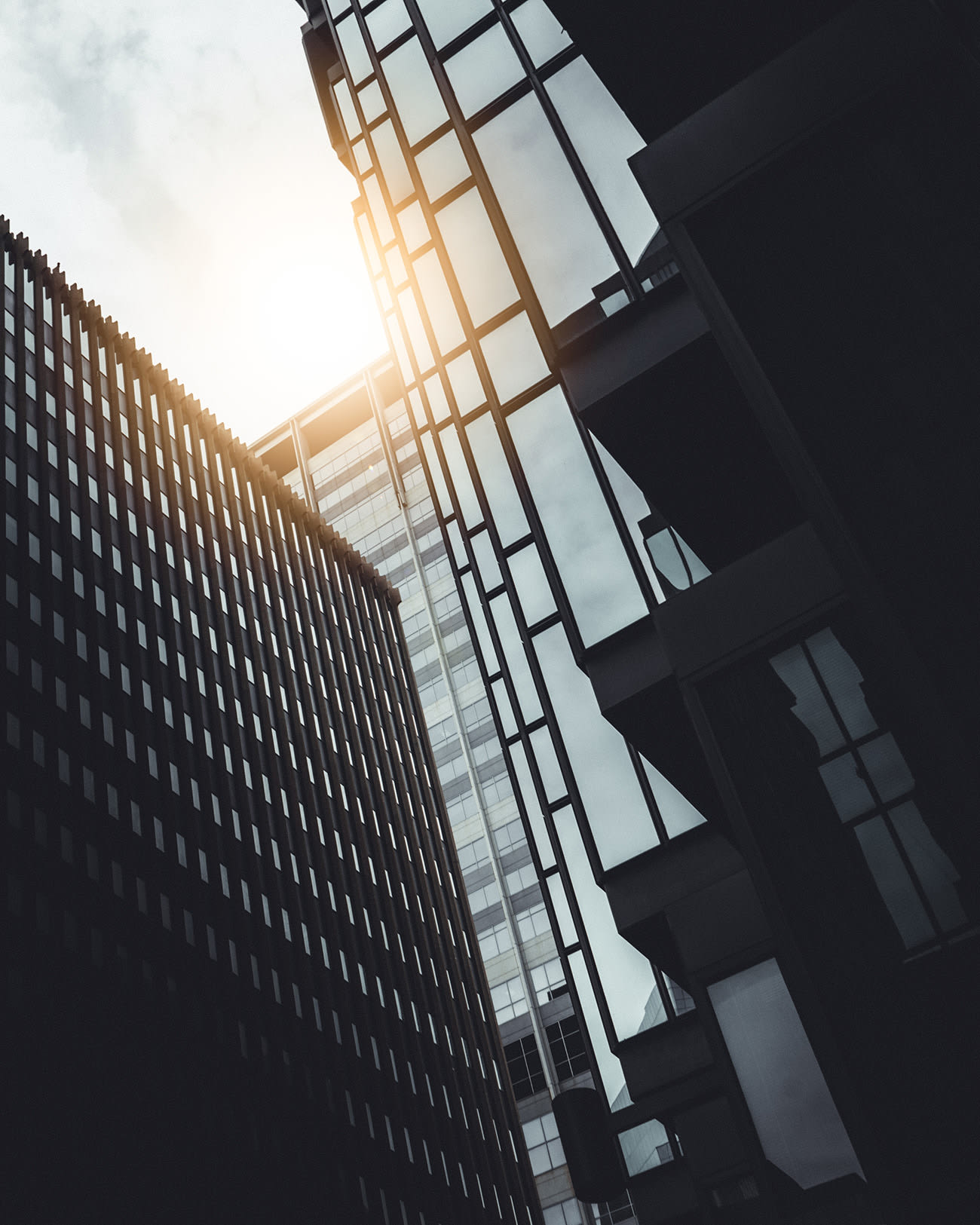 Picture of building with the sun shining down