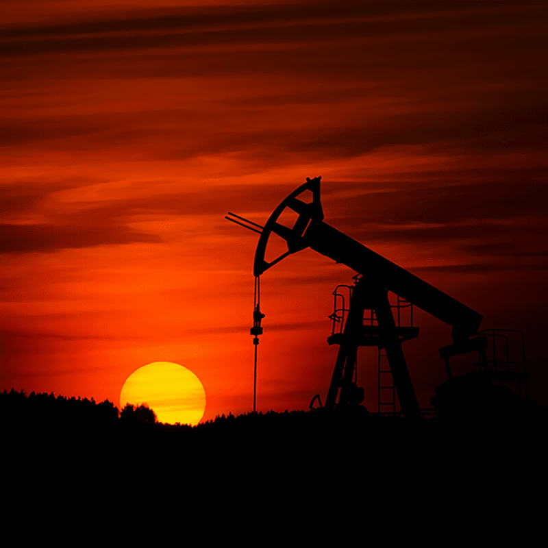 An oil well at sunset